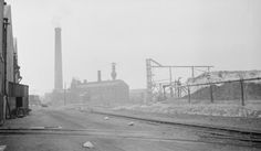 Paul Nash Black and white negative, factory site, Pilkington's glass factory, St Helens, Lancashire 1935 St Helens Town, Saint Helens, Pilkington Glass, Work Opportunities, Cn Tower, Landscapes, Archive, Comic, England