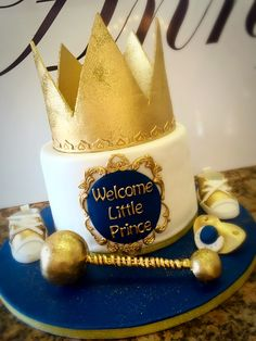 Little Princes baby shower cake with gold crown and navy blue details