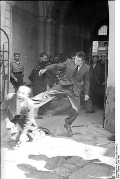 A civilian kicking a Jewish man, Soviet Union, June 1941.