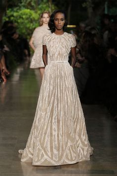 this Elie Saab gown depicts American Lifestyle through it's classic style with an updated feel in the detailing. The silhouette reminds me of something Jackie O would have worn back in her day but modern enough for first lady Michelle Obama to wear today, and it is absolutely stunning. Though not intended as a wedding gown necessarily, this would be an absolute show-stopper and I can see an American bride rocking it as an unexpected wedding gown. #USbridalmonth #bcnbridalweek