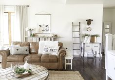 A farmhouse summer home tour - LIVING ROOM. You must check this home tour out!