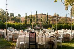 mismatch chairs #wedding #outside