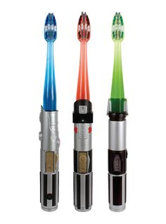 Star Wars Lightsaber Toothbrush. Oh my goodness, I totally need this!! :D