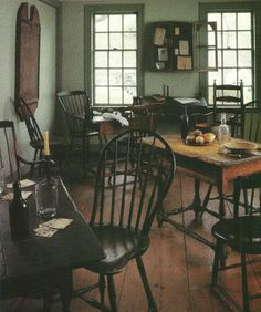 FARMHOUSE – INTERIOR – vintage early american farmhouse showcases raised panel walls, barn wood floor, exposed beamed ceiling, and a simple style for moulding and trim, like in this colonial tavern room.