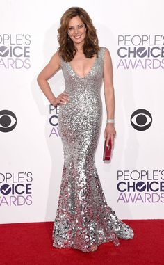 Allison Janney from 2015 People's Choice Awards Red Carpet Arrivals  Holy hot! Allison strikes gold, err silver, in this curve-hugging Rani Zakhem gown.