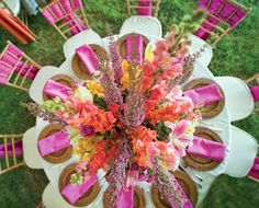 Just the right amount of hot pink. Linens, rattan chargers, natural chiavari chairs @POSH Couture Rentals. Florals @Di Fiori