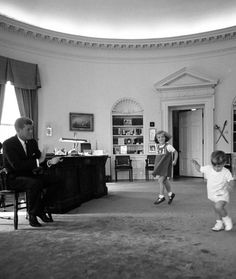 President Kennedy, Caroline and John Jr. in the Oval Office of the White House in Washington D.C. (1962) • photo: Cecil Stoughton / The White House
