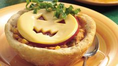 A bright Halloween smile tops a quick chicken stew in a biscuit bread bowl.