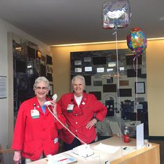 Scenes from D-H Volunteer Services: Viola Ward and Ann Jones ready to help welcome patients and families at the Escort Desk! #volunteerweek #DHPX
