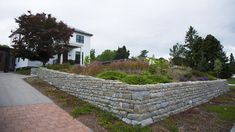 These beautiful walls and features are built stone by stone, with no mortar used to cement the stones together. While the concept sounds intimidating to some, our specialized teams are well-versed in dry stone construction. Aesthetic Look, Dry Stone, Landscape Services, Stone Walls, Retaining Walls, Concrete Blocks, Sidewalk, Exterior, Fire