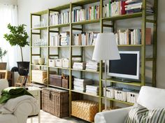 IVAR 4 sections with shelves.  Love the baskets and trunks - ideas to keep it less crazy-looking!