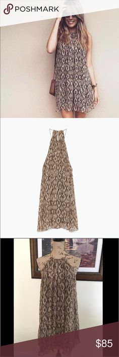 Zara Festival Halter Neck Dress Zara Festival Halter Neck Dress.  Snakeprint halter flowing mini dress. NWT.  Adorable and fun.   ZARA WOMAN COLLECTION  SIZE M  UK 10  COMPOSITION: OUTER SHELL: 100% VISCOSE, LINING: 100% POLYESTER Zara Dresses Mini