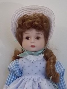 "Part of the Gorham 5th Anniversary Doll Collection. Mary, Mary Quite Contrary is a vintage porcelain doll that's about 16"" tall. Included in the musical series; she plays ""Hi Lilli, Hi-Lo"". This timel"