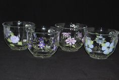 The Violet Collection at www.TheColorfulWife.com!  Hand painted dinner and glassware that is made in Michigan.