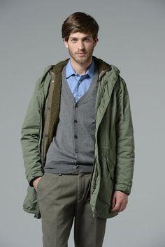Shop this look on Lookastic:  http://lookastic.com/men/looks/light-blue-longsleeve-shirt-grey-cardigan-green-parka-grey-chinos/5780  — Light Blue Long Sleeve Shirt  — Grey Cardigan  — Green Parka  — Grey Chinos
