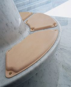 Marc Newson Ltd - imagine circuit board cushions bolted to concrete...look at how the cushion is fastened like a circuit board