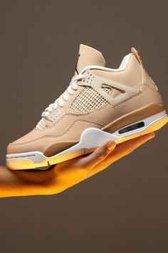 """There's every reason to believe that the new Women's Air Jordan 4 """"Shimmer"""" is actually a subtle nod to Japanese craftsman Hender Scheme's tribute to the vintage basketball shoe from 2015. Both share a similar monochromatic pink/orange vibe."""