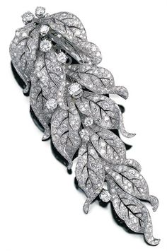 Paul Flato, articulated diamond and platinum cascade brooch, circa 1936 --  photo by Talking Jewellery, via Flickr
