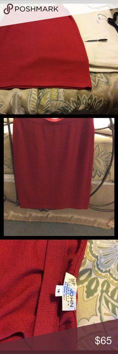 Red St. John skirt Red knit St. John skirt. The right inside of hem is loose. Last picture shows St. John Skirts Midi