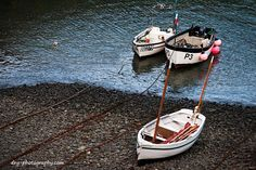 Boats rest at Clovelly harbour