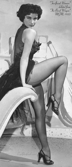 Seamed stockings and all. (Cyd Charisse)