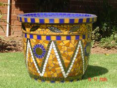 Mosaic garden pot by Lisa b