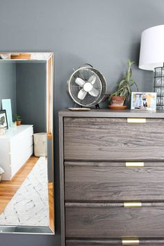We finally did it and followed through on putting ourmaster bedroom first! We pulled the trigger on ditching Jordan's old dresser and getting ourselves a