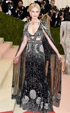2016 Met Gala: Nicole Kidman is a glam queen in a beaded Alexander McQueen gown with cutouts on the bodice and matching sheer beaded cape. Amazing and exquisite gown! Gorgeous from head to toe!