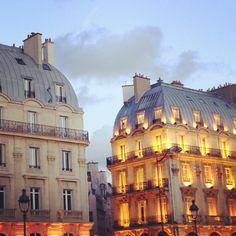 Parisian building at dusk.