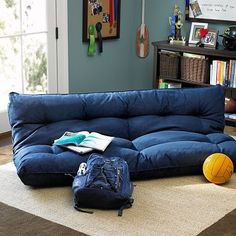 I love the Double Flip Floor Lounger on  it would be perfect for mikes guy room!!  pbteen.com