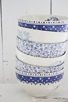 Blue and white bowls  -  been mixing and matching blue and white for decades! Must be a trend setter!