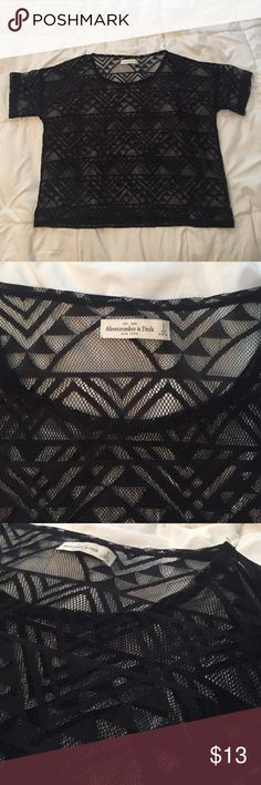 🆕 Abercrombie and Fitch sheer Aztec lace tee Abercrombie and Fitch black sheer lace tee, in Aztec style lace. Size small. Please feel free to ask any questions or make an offer! 🙂 Abercrombie & Fitch Tops