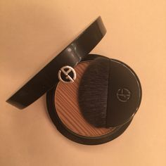 Michelle's favorite natural bronzer this summer is Armani Bronzer