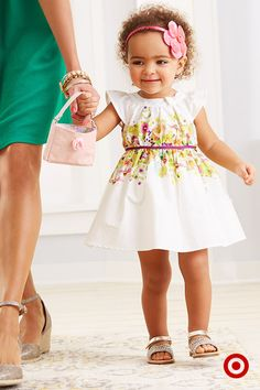 Mommy-Daughter time is always special, but heading out together in beautiful dresses makes it even better! Your little girl will feel like a princess in this springtime classic—a floral-print dress accessorized with pink headband and purse. Yeah… you both look great!
