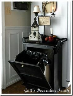 Great idea.  Use a hidden hamper as an in-table with a trash can in place of the hamper to throw out all our junk mail when we first walk in!