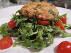 Wild salmon patties with avocado arugula salad