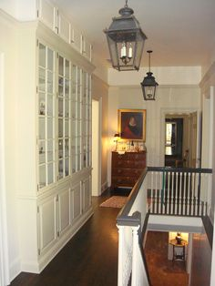 Wood floor, built-ins, chest, art, beautiful lanterns