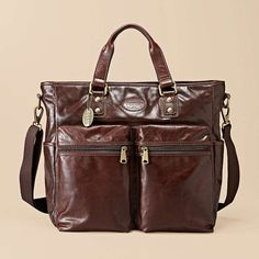 Fossil: Transit Utility Bag...Evocative of vintage flight bags, our Transit collection has a retro-refined look and utility-inspired design that we love. Rich leather and ample cargo pockets make this our most-coveted bag for the season.