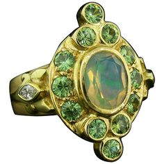 View this item and discover similar for sale at - This ring was designed and made by well known designer Paula Crevoshay. It contains a very unique, beautifully colored Mexican Opal weighing carats. Russian Jewelry, Garnet And Gold, Garnet Jewelry, Right Hand Rings, Cocktail Rings, Statement Rings, Bracelet Watch, Opal, Gold Rings
