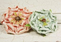 Welcome back to another flower tutorial! I was browsing through Prima flowers and I came across these beautiful blooms They inspired me ...