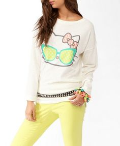 A Hello Kitty® Forever Collection Exclusive, this speckled relaxed fit top features a cool Hello Kitty® graphic with geometric details. Round neckline. Dropped shoulders. Long sleeves with stitched down cuffs. Side vents. Squared hemline. Knit. Lightweight.