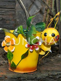 Carpenter worm pot!! Elevate the charm of your garden area with this yellow coloured planter.