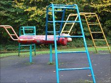 I also remember a different park from my childhood that had one of these. My mum remembers my sister falling of off it - and yes it was tarmac underneath - nothing soft and safe! (but she didn't hurt herself though).