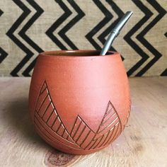 Raw terracotta yerba mate cup with geometric carvings. Glazed Guild Honey on the inside. Bombilla (filter straw) included! Works for any loose tea.  Food, microwave, dishwasher safe.