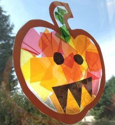 This stained glass pumpkin is a cute Halloween craft for kids that can also help to teach them about colour mixing!