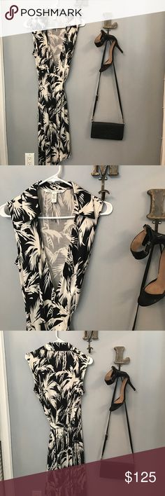 DVF: Black and White Tropical Print Dress Black and white tropical print wrap dress in famous 100% silk material.   Fit: Comfortably fitted  Perfect for: Cocktail Party, Fancy Day Event   Paired with: Black ankle strap sandal from Zara and black Tory Burch cross body   Note: there is a small yellow stain from ironing on the top left side. Barely noticeable Diane von Furstenberg Dresses Strapless