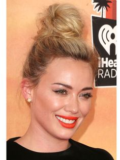 Who: Hilary Duff The Expert: Celebrity makeup artist Adam Breuchaud (Instagram @adambreuchaud) The Look: Orange-y Lip for Spring The Tip: 1. Apply two coats of thick mascara. (Adam used L'Oreal Volumimous Mascara). Adam added a few individual faux-lashes on Hilary for maximum impact! 2. The rest of the makeup is clean and fresh to highlight the bold lip. Adam sculpted Hilary's cheeks with Chanel Les Beiges Healthy Glow Powder, but you can also try Revlon PhotoReady Powder to achieve the…