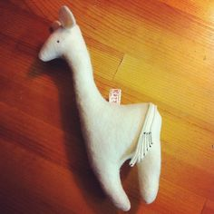 wool felt llama like creature with rattle :)