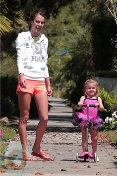 Alessandra with daughter Anja and her pink Mini Micro in Beverly Hills