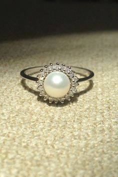 Diamond and pearl engagement ring